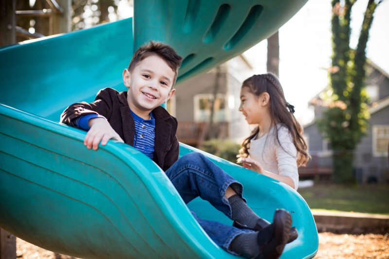 Siblings at playground in Portland Oregon