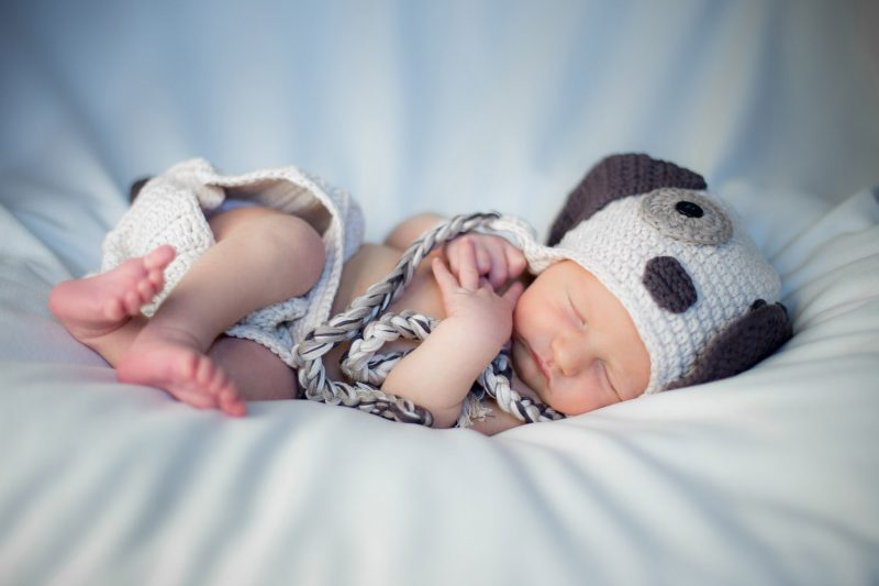 Newborn boy in window light