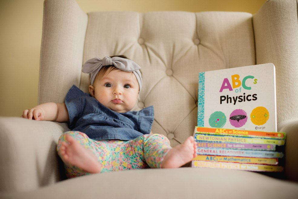 Baby's First Year in Photos - seated with baby books