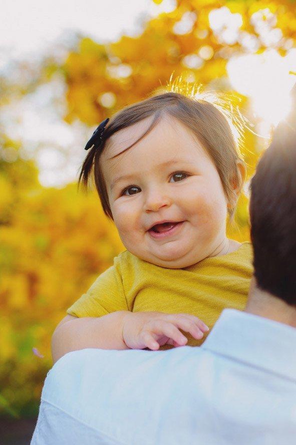 Baby's First Year in Photos - 9 months dad holder her