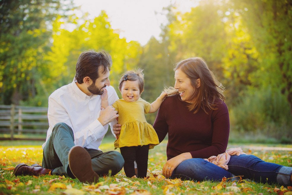 Baby's First Year in Photos - Baby standing with parents