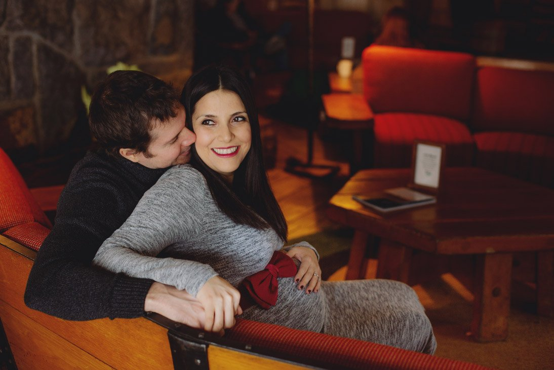 Maternity Photo Session - Embracing on couch, smiling at camera