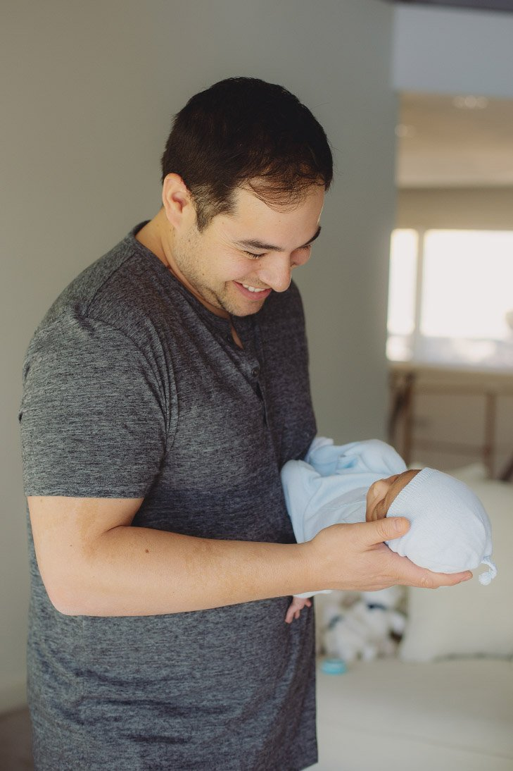Newborn Photo Session - Dad Smiling with Baby
